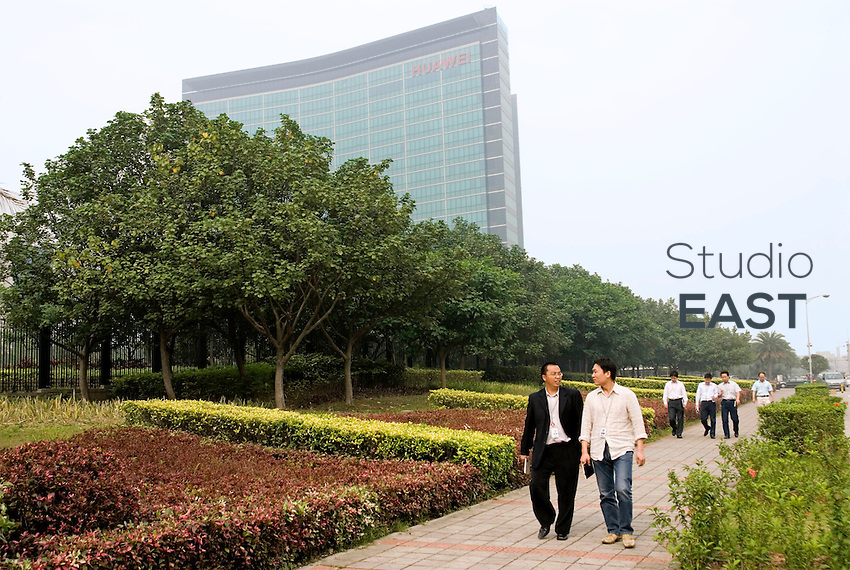 Pedestrians walk by Huawei's Research & Development building in Huawei's Bantian Longgang campus, outside Shenzhen, Guangdong province, China, on April 26, 2008. With more than 30,000 employees in its campus of Bantian Longgang, Shenzhen, HuaWei Technologies is a leader in telecommunications networks. Photo by Vincent Assante Di Cupillo/Pictobank