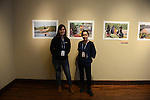 National Geographic Young Explorers Julia Harte and Anna Ozbek stand in front of photographs documenting the cultures along the Tigris River effected by the construction of the Ilisu dam in southeastern Turkey both now and in the future including the 4,000 year old Hasankeyf, on exhibit at the Aa Haa West Gallery during the Mountainfilm Festival in Telluride, Colorado on May 22, 2015.