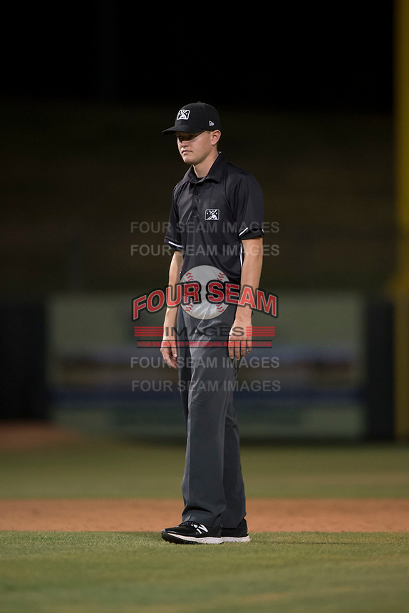 Field umpire Benjamin Engstrand during an Arizona League game between the AZL Athletics and the AZL Angels at Tempe Diablo Stadium on June 26, 2018 in Tempe, Arizona. The AZL Athletics defeated the AZL Angels 7-1. (Zachary Lucy/Four Seam Images)