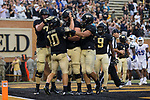 John Wolford (10) of the Wake Forest Demon Deacons is congratulated by his teammates after scoring a touchdown on a 2-yard run during first half action against the Presbyterian Blue Hose at BB&T Field on August 31, 2017 in Winston-Salem, North Carolina.  The Demon Deacons defeated the Blue Hose 51-7.  (Brian Westerholt/Sports On Film)