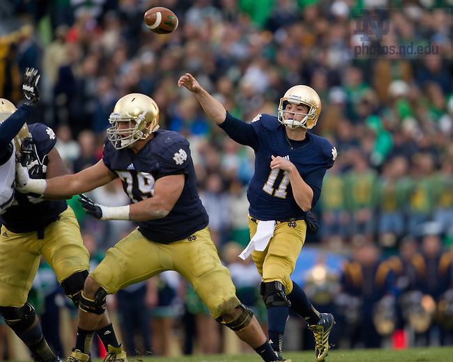 Nov. 2, 2013; quarterback Tommy Rees (11) throws for a touchdown against Navy.<br /> <br /> Photo by Matt Cashore
