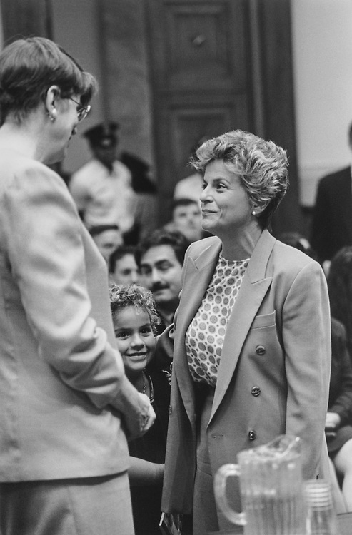 Attorney General Janet Reno talks with Rep. Ileana Ros-Lehtinen, R-Fla., and daughter Patricia, (7 age) in center, on Aug 3, 1995. (Photo by Laura Patterson/CQ Roll Call via Getty Images)