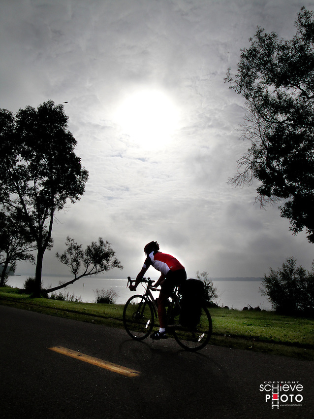 A bicyclist takes an early morning ride on the Lake Monona bike path in Madison, Wisconsin.