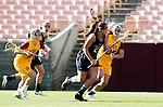 Los Angeles, CA 02/09/13 - Caroline Cordrey (USC #15), Caroline de Lyra (USC #25) and Alyssa Leonard  (Northwestern #2) in action during the Northwestern vs USC NCAA Women Lacrosse game at the Los Angeles Colliseum.