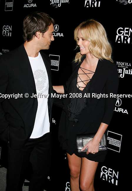 "BEVERLY HILLS, CA. - September 22: Writer/director Stuart Townsend and actress Charlize Theron arrive at a special screening of ""Battle in Seattle"" held at the Clarity Theater on Monday September 22, 2008 in Beverly Hills, California."