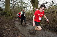 06 FEB 2011 - SIBBERTOFT, GBR - Competitors make their way through the brook during the Avalanche Adventure Run .(PHOTO (C) NIGEL FARROW)