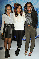"HOLLYWOOD, CA - NOVEMBER 19: China Anne McClain, Sierra McClain, Lauryn McClain, McClain Sisters at the World Premiere Of Walt Disney Animation Studios' ""Frozen"" held at the El Capitan Theatre on November 19, 2013 in Hollywood, California. (Photo by David Acosta/Celebrity Monitor)"