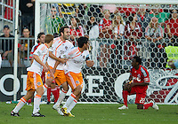 01 July 2010:  Houston Dynamo players celebrate a goal by Houston Dynamo forward Brian Ching #25 in the seventy second minute during a game between the Houston Dynamo and the Toronto FC at BMO Field in Toronto..Final score was 1-1....