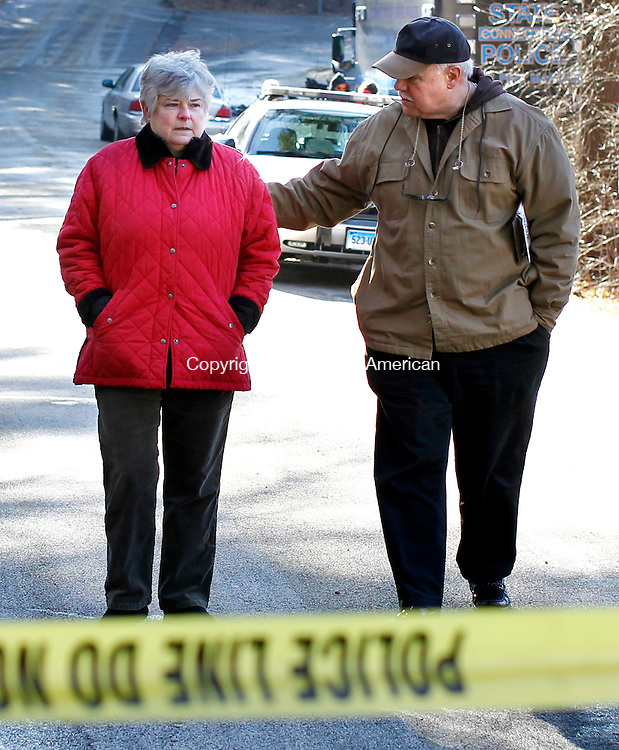 Norfolk, CT-18 December 2011-121811CM01-   Mary Fanette (left) President of the Norfolk Curling Club is consoled by Nick Fanelli, an insurance rep with Raynard & Peirce Insurance after leaving the scene of an suspected arson that destroyed the Curling Club building in Norfolk late Saturday night. Christopher Massa Republican-American