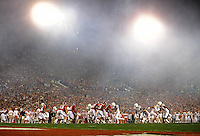 Jan 7, 2010; Pasadena, CA, USA; Alabama Crimson Tide players defend against the Texas Longhorns in the first quarter during the 2010 BCS national championship game at the Rose Bowl. Alabama defeated Texas 37-21. Mandatory Credit: Mark J. Rebilas-