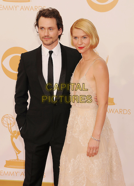 Hugh Dancy &amp; Claire Danes<br /> The 65th Annual Primetime Emmy Awards - Arrivals held at The Nokia Theatre L.A. Live in Los Angeles, California, USA.<br /> September 22nd, 2013<br /> half length suit dress white cream lace plunging neckline cleavage married husband wife black <br /> CAP/ROT/TM<br /> &copy;Tony Michaels/Roth Stock/Capital Pictures