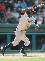 Infielder Anderson Feliz (10) of the Charleston RiverDogs, Class A affiliate of the New York Yankees, in a game against the Greenville Drive on May 15, 2011, at Fluor Field at the West End in Greenville, S.C. Photo by Tom Priddy / Four Seam Images