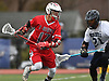 Steven Pinto #17 of Connetquot, left, gets pressured by Jared Leake #21 of Huntington during a Suffolk County varsity boys lacrosse game at Huntington High School on Friday, April 7, 2017. Pinto scored four goals, including three in the fourth quarter, to rally Connetquot from a 12-10 deficit in the final period to a 15-14 win.