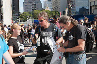 Protesters hand out literature at the WTC PATH station.