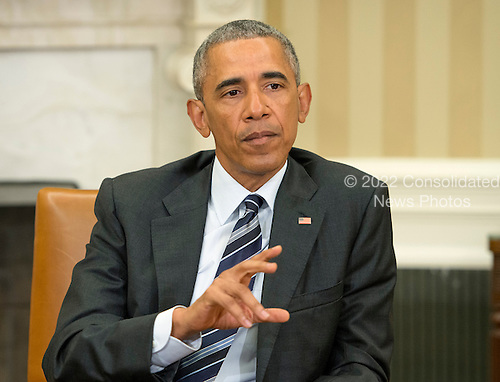 United States President Barack Obama makes remarks to the media after receiving an update on the investigation into the attack in Orlando, Florida in the Oval Office of the White House in Washington, DC on Monday, June 13, 2016. <br /> Credit: Ron Sachs / Pool via CNP