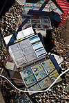 A ruined book of baseball cards sits on the ground in front of a home ruined by  Superstorm Sandy on Brook Avenue in Union Beach, New Jersey.  Photo By Bill Denver