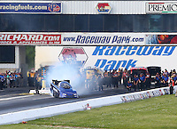 May 31, 2014; Englishtown, NJ, USA; NHRA funny car driver Mike Smith goes sideways during qualifying for the Summernationals at Raceway Park. Mandatory Credit: Mark J. Rebilas-