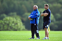 Bath Director of Rugby Gary Gold and Forwards coach Neal Hatley watch training. Bath Rugby training session on October 17, 2013 at Farleigh House in Bath, England. Photo by: Patrick Khachfe/Onside Images