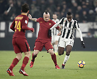 Calcio, Serie A: Juventus - AS Roma, Torino, Allianz Stadium, 23 dicembre, 2017. <br /> Juventus' Blaise Matuidi (r) in action with Roma's Radja Nainggolan (l) during the Italian Serie A football match between Juventus and Roma at Torino's Allianz stadium, December 23, 2017.<br /> UPDATE IMAGES PRESS/Isabella Bonotto