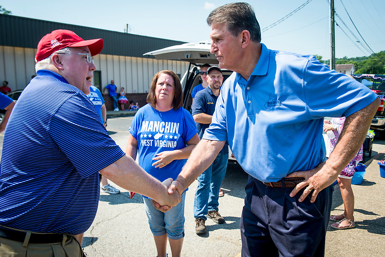UNITED STATES - July 4: Sen. Joe Manchin, D-W.Va., shakes hands with Attorney General Patrick Morrisey, who is also running for U.S. Senate, before the start of the Ripley 4th of July Grand Parade in Ripley, West Virginia<br />