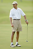 President Barack Obama reacts to his missed putt on the 18th hole at the Mid Pacific Country Club. January 1, 2014. photo Cory Lum<br /> Credit: Cory Lum / Pool via CNP