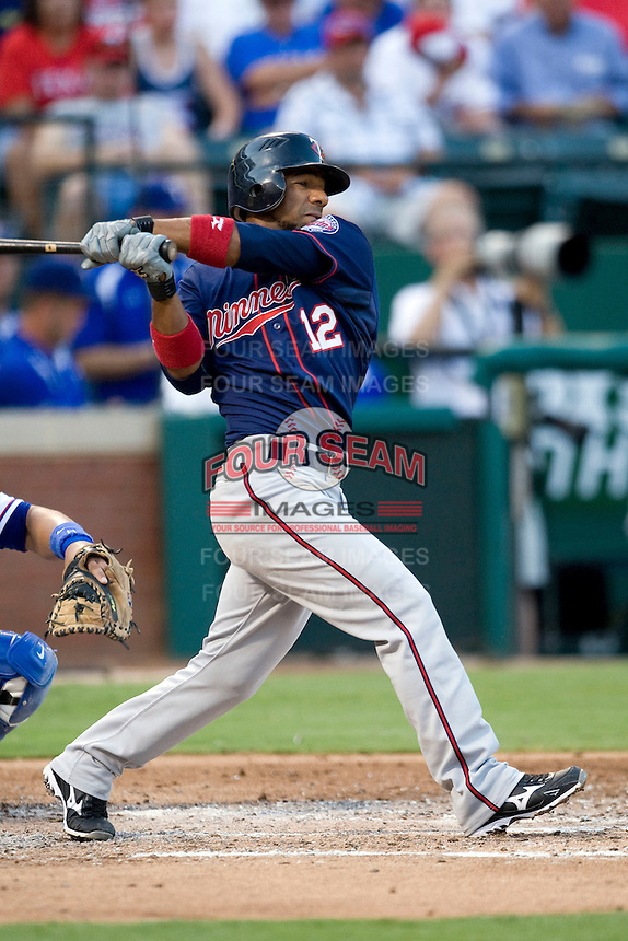 Minnesota Twins second baseman Alexi Casilla #12 swings during a Major League Baseball game against the Texas Rangers at the Rangers Ballpark in Arlington, Texas on July 27, 2011. Minnesota defeated Texas 7-2.  (Andrew Woolley/Four Seam Images)