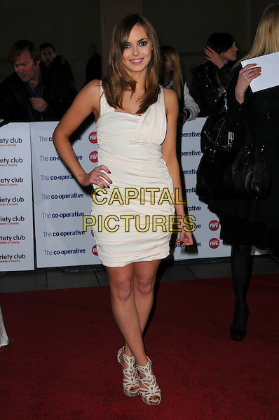 HANNAH TOINTON .The Co-operative Variety Club Showbiz Awards, Grosvenor House Hotel, Park Lane, London, England, UK, .14th November 2010. .full length cream ruched dress hand on hip white platform peep toe shoes hand on hip .CAP/CAS.©Bob Cass/Capital Pictures.