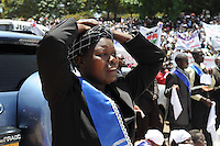 A woman prays at the Kenya Repents peace rally. Led by the self-styled prophet David Owuor, tens of thousands of Kenyans camped out in Uhuru Park over the weekend of 23 February 2013 to renounce violence in the lead up to the historic elections on 4 March, the first since the post-election violence of 2007/08  that left more than 1,200 dead and 600,000 displaced.