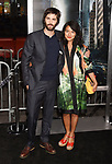 HOLLYWOOD, CA - OCTOBER 16: Actor Jim Sturgess (L) and actress Dina Mousawi attend the premiere of Warner Bros. Pictures' 'Geostorm' at the TCL Chinese Theatre on October 16, 2017 in Hollywood, California.