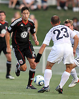 Branko Boskovic #27 of D.C. United takes the ball to Anthony Calvano #23 of the Harrisburg City Islanders during a US Open Cup match at the Maryland Soccerplex on July 21 2010, in Boyds, Maryland. United won 2-0.