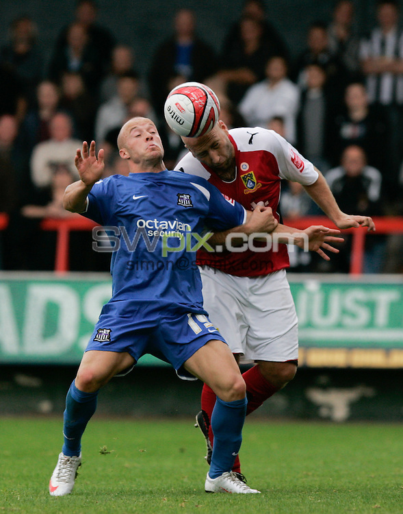 PICTURE BY Jon Buckle/SWPIX.COM - Football, League division 2 Morecambe v Notts County........19/09/09..Morecambe's  Danny Adams challenges Notts County's Luke Rodgers..Copyright - Simon Wilkinson - 07811267706.
