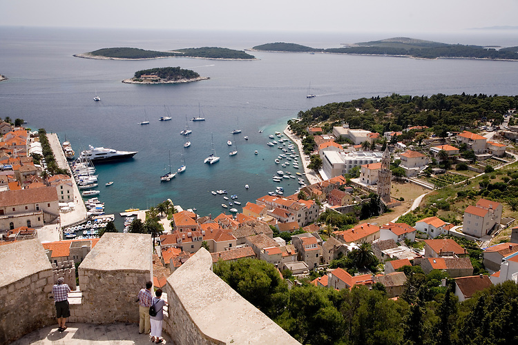 Hvar town clusters around its harbor. Overlooking the town and harbor is a mighty hilltop fortress.