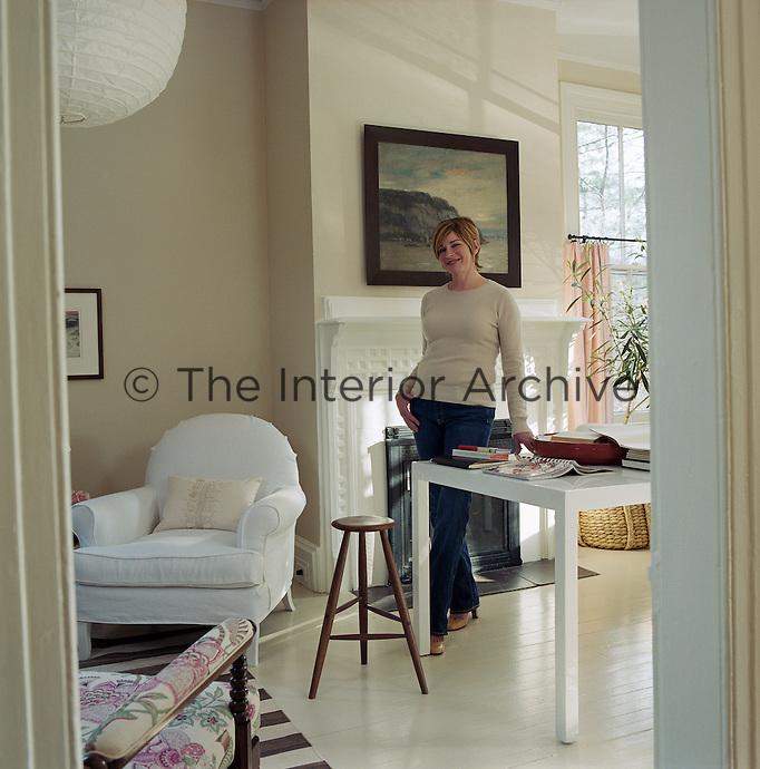 Portrait of interior designer Sharon Simonaire standing in her living room