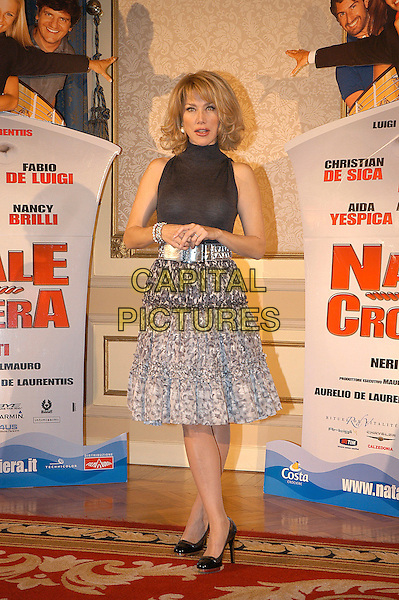 NANCY BRILLI.Photocall for the film di Neri Parenti 'Natale in crociera'.December 13th, 2007.full length black top grey gray silver skirt pattern .CAP/CAV.©Luca Cavallari/Capital Pictures.