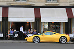 Waiter looking at yellow Ferrari sports car parked in front of a restaurant, Paris, France. .  John offers private photo tours in Denver, Boulder and throughout Colorado, USA.  Year-round. .  John offers private photo tours in Denver, Boulder and throughout Colorado. Year-round.