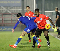 Brighton's Kazenga Lua Lua takes on AFC Wimbledon's George Francombe during the The Checkatrade Trophy match between AFC Wimbledon and Brighton & Hove Albion Under 21s at the Cherry Red Records Stadium, Kingston, England on 6 December 2016. Photo by Carlton Myrie / PRiME Media Images