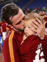 Calcio, Serie A: Roma vs Palermo. Roma, stadio Olimpico, 31 maggio 2015.<br /> Roma's  Miralem Panic kisses his son Edin at the end of the Italian Serie A football match between Roma and Palermo at Rome's Olympic stadium, 31 May 2015.<br /> UPDATE IMAGES PRESS/Riccardo De Luca