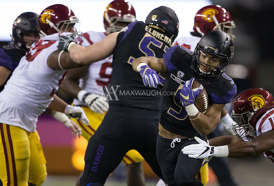 Myles Gaskin looks for room to run.  Gaskin finished with 51 yards rushing.