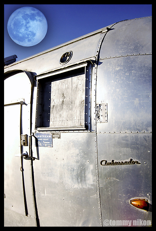 "Airstream trailer/circa 1961...atop parking garage as tool shed for a ""pea patch"", in-city gardening."