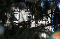 Papa Francesco recita l'Angelus domenicale affacciato su piazza San Pietro dalla finestra del suo studio. Citta' del Vaticano, 3 dicembre, 2017.<br /> Pope Francis is seen through the branches of a Christmas tree during the Sunday Angelus noon prayer from the window of his studio overlooking St. Peter's Square, at the Vatican, on December 3, 2017.<br /> UPDATE IMAGES PRESS/IsabellaBonotto<br /> <br /> STRICTLY ONLY FOR EDITORIAL USE