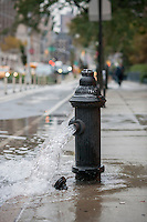 Water gushes from an open fire hydrant in in New York on Thursday, October 27, 2016 as the Department of Environmental Protection flushes out a water line. (© Richard B. Levine)