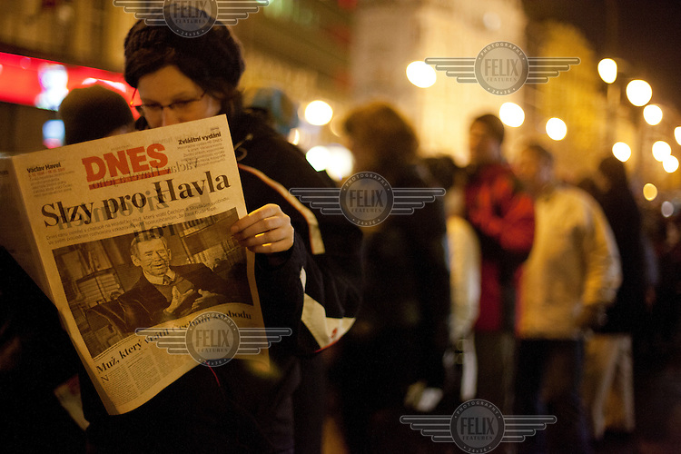 A woman reads a copy of Mlada Fronta Dnes, one of the biggest Czech newspapers, whose front page reads 'Tears for Havel'. The newspaper published a special edition after it was announced that Vaclav Havel had died. Havel was a playwright, essayist and poet who became active as a dissident after the Soviet Invasion of Czechoslovakia and ended up being the last president of united Czechoslovakia and the first president of the independent Czech Republic. He died on 18 December 2011 at the age of 75.