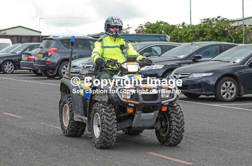 Policeman on a quad patrols car parks during the event. 201207270443..Photo taken 27th June 2012 on the first tee, Pro-Am competition, Irish Open Championship, Royal Portrush Golf Club, N Ireland...© Victor Patterson, 54 Dorchester Park, Belfast, N Ireland. Tel: +44 2890661296; Mobile: +44 7802 353836; Emails: victorpatterson@me.com & victorpatterson@gmail.com; www.victorpatterson.com