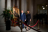 President Donald Trump and first lady Melania Trump walk past a painting of the late Supreme Court Justice John Paul Stevens after they pay their respects as he lies in repose in the Great Hall of the Supreme Court in Washington, Monday, July 22, 2019.<br /> Credit: Andrew Harnik / Pool via CNP