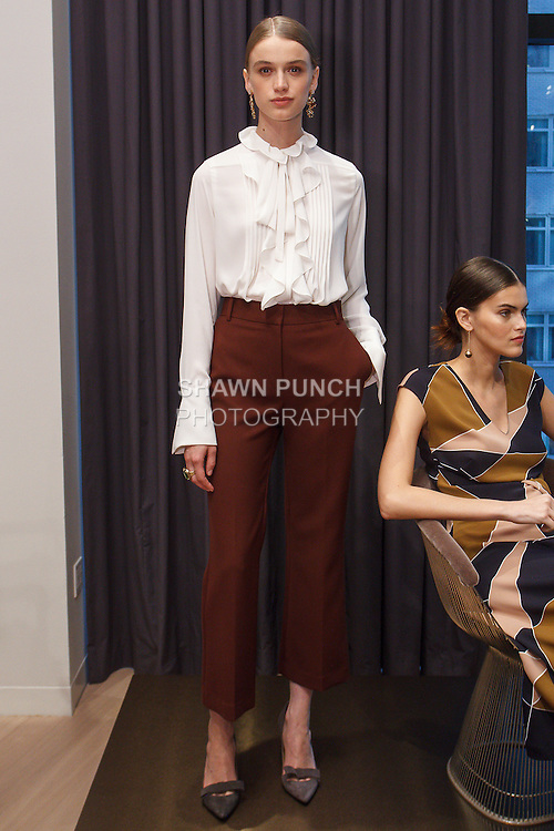 Model poses in an outfit from the Ann Taylor Fall Winter 2016 collection by Austyn Zung, at 7 Times Square on April 20, 2016.