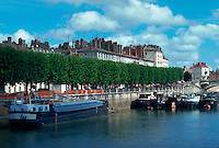 View of Chalon sur Saone from Saone River, town, river and barges on the water.