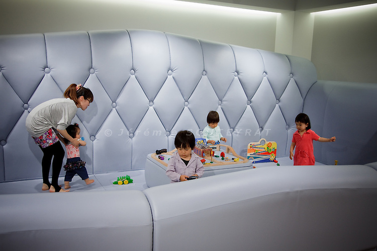 Tokyo, May 12, 2010 - Baby cafe in Omotesando, where mothers can get together while their children are playing in a giant sofa. Space design by Nendo.