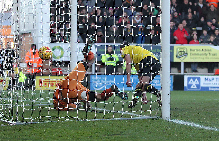 Burton Albion's Phil Edwards scores the opening goal beating Bury's Nick Pope<br /> <br /> Photographer Mick Walker/CameraSport<br /> <br /> Football - The Football League Sky Bet League Two - Burton Albion v Bury - Saturday 31st January 2015 - Pirelli Stadium - Burton upon Trent<br /> <br /> &copy; CameraSport - 43 Linden Ave. Countesthorpe. Leicester. England. LE8 5PG - Tel: +44 (0) 116 277 4147 - admin@camerasport.com - www.camerasport.com