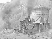 D&amp;RGW #497 with a heavy eastbound freight passing Cresco Tank.<br /> D&amp;RGW  Cresco, CO  Taken by Bender, Henry E. Jr. - 6/22/1963