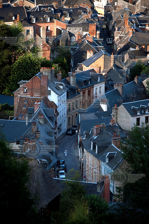 An aerial view over a street and houses in Honfleur.